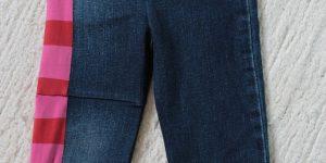 Babybyxor sydda av jeans och tröja.